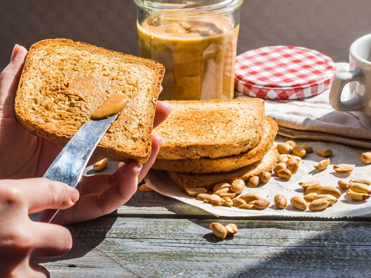 Side Effects of Eating Too Much Peanut Butter, Say Dietitians
